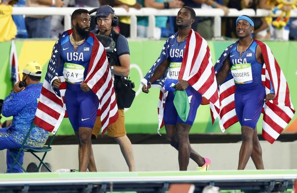 Tyson Gay, Justin Gatlin and Mike Rodgers of the U.S. 400-meter relay team. (Peter Klaunzer / EPA)