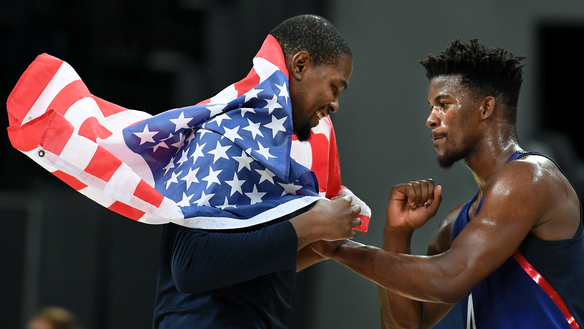 USA's Kevin Durant, left, and Jimmy Butler celebrate after winning the gold medal. (Wally Skalij / Los Angeles Times)