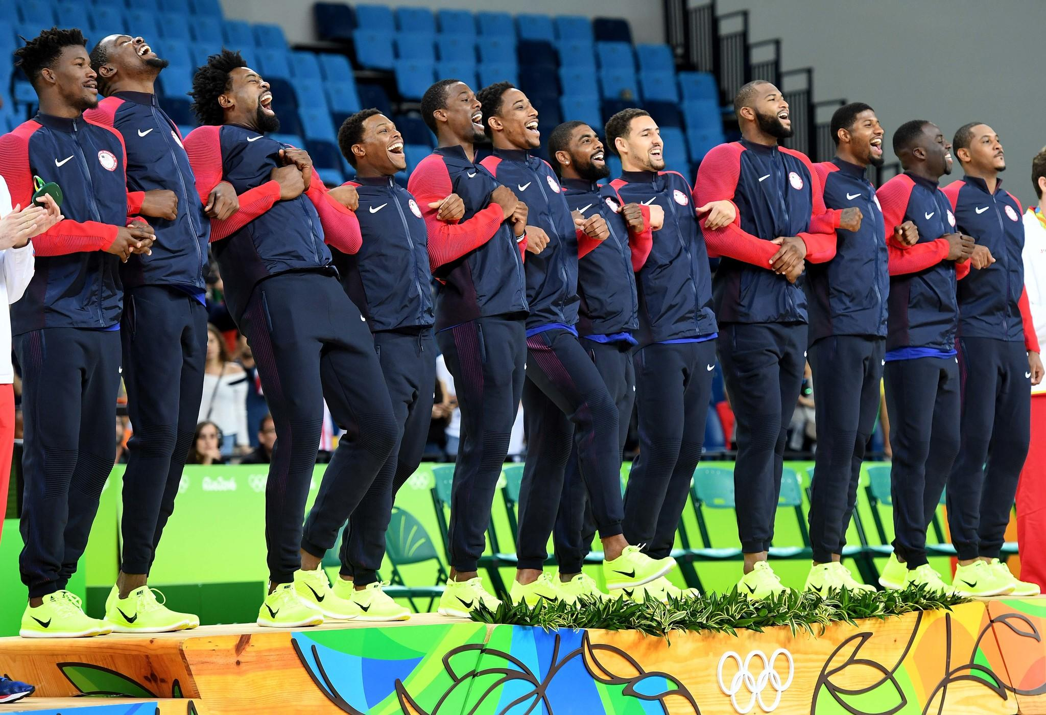 The U.S. men's basketball steps up to podium to receive their gold medals. (Wally Skalij / Los Angeles Times)