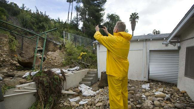 Guy Lawyer takes photos of the large broken storm drain water pipe that broke in a & Busted storm pipe floods homes after months of warnings - The San ...