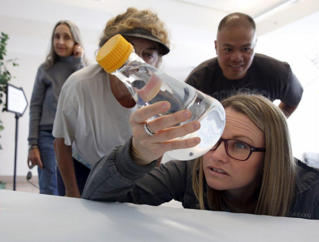 San Diego Unified School District teacher Tiffanie Glaze inspects water processed at the city's Pure Water facility during a recent tour. The visit was part of San Diego Coastkee