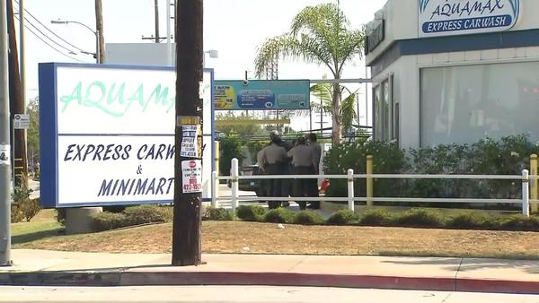 Ax-wielding man holed up in Carson carwash is a former employee, officials say