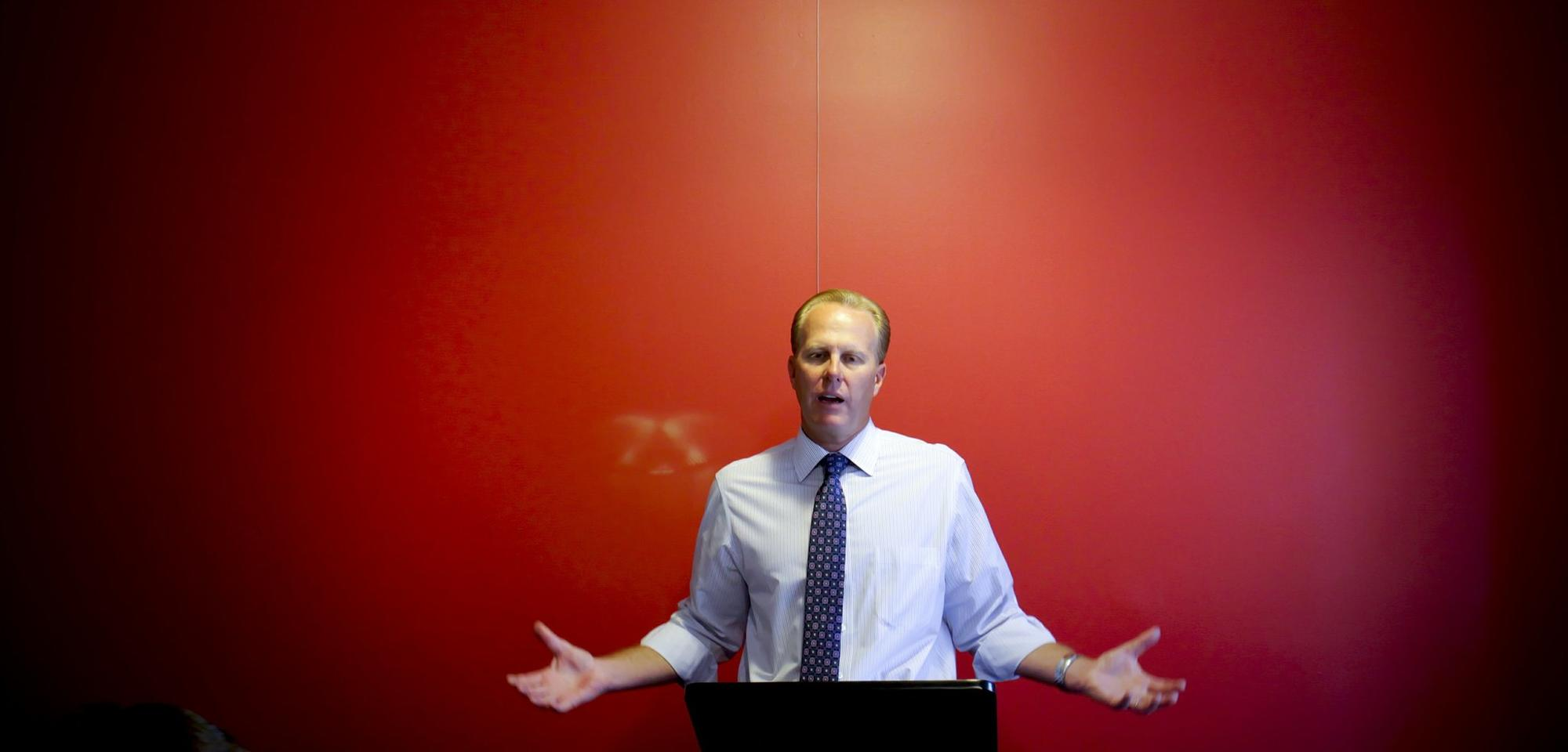 San Diego City Council member and mayoral candidate Kevin Faulconer prepares for the first mayoral debate with campaign staff members at a downtown consulting firm.