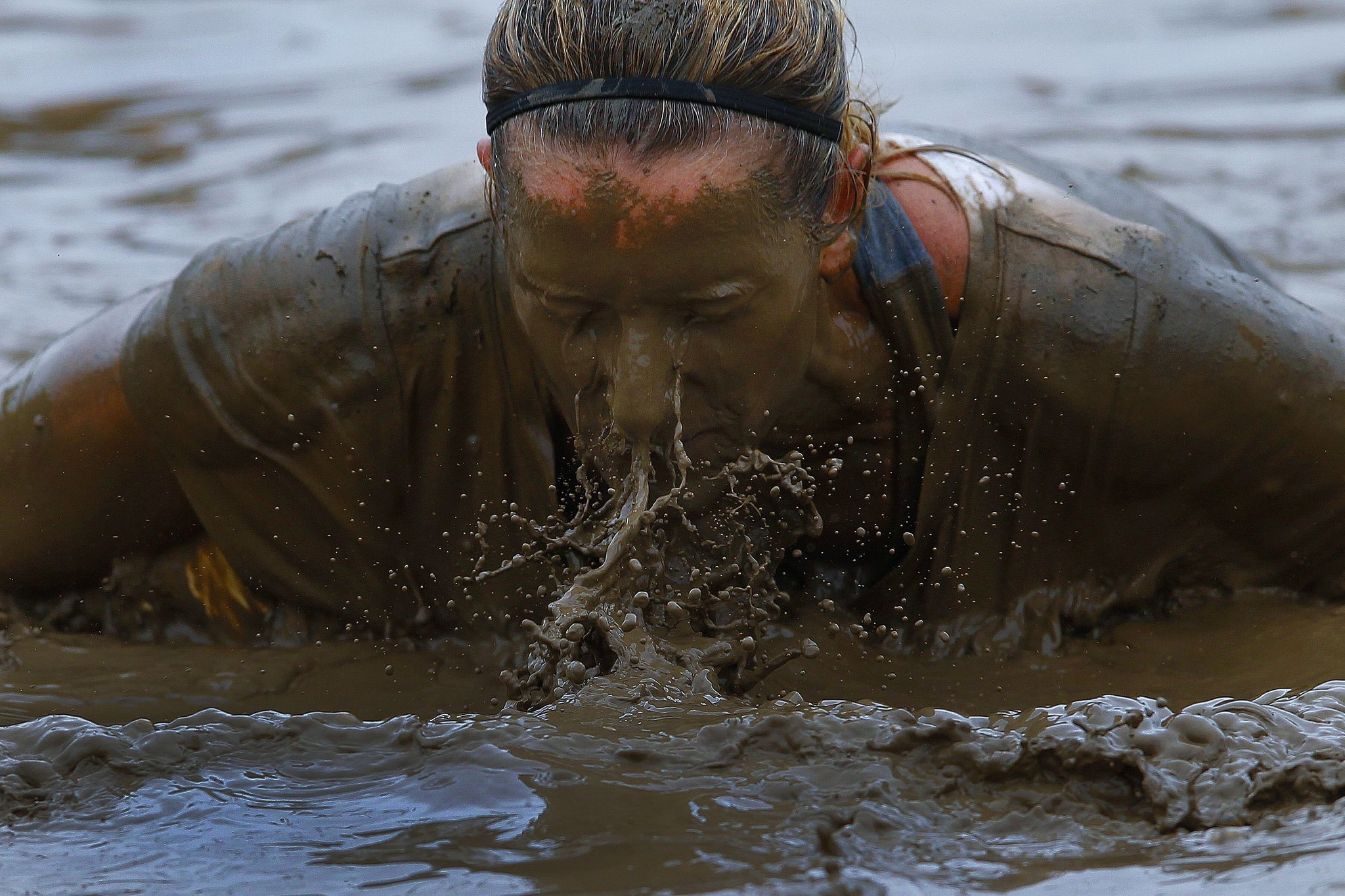 Runners slog through Marine style obstacles in annual Mud Run The