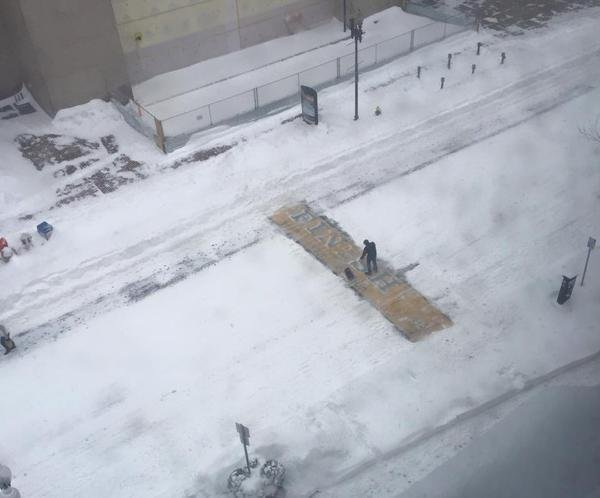 'Boston strong' is a guy shoveling snow off the Boston Marathon finish line in a blizzard