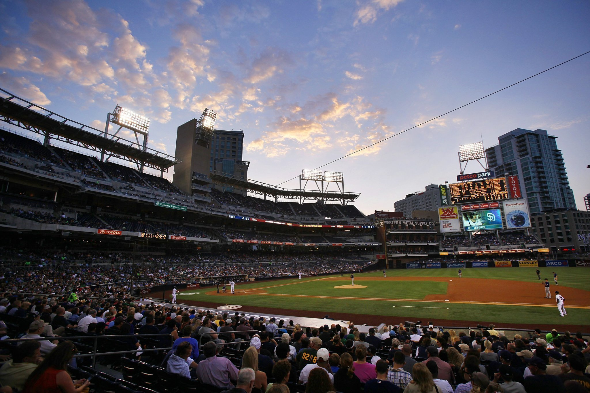 Can I buy official Padres Merchandise before a game in PETCO Park?
