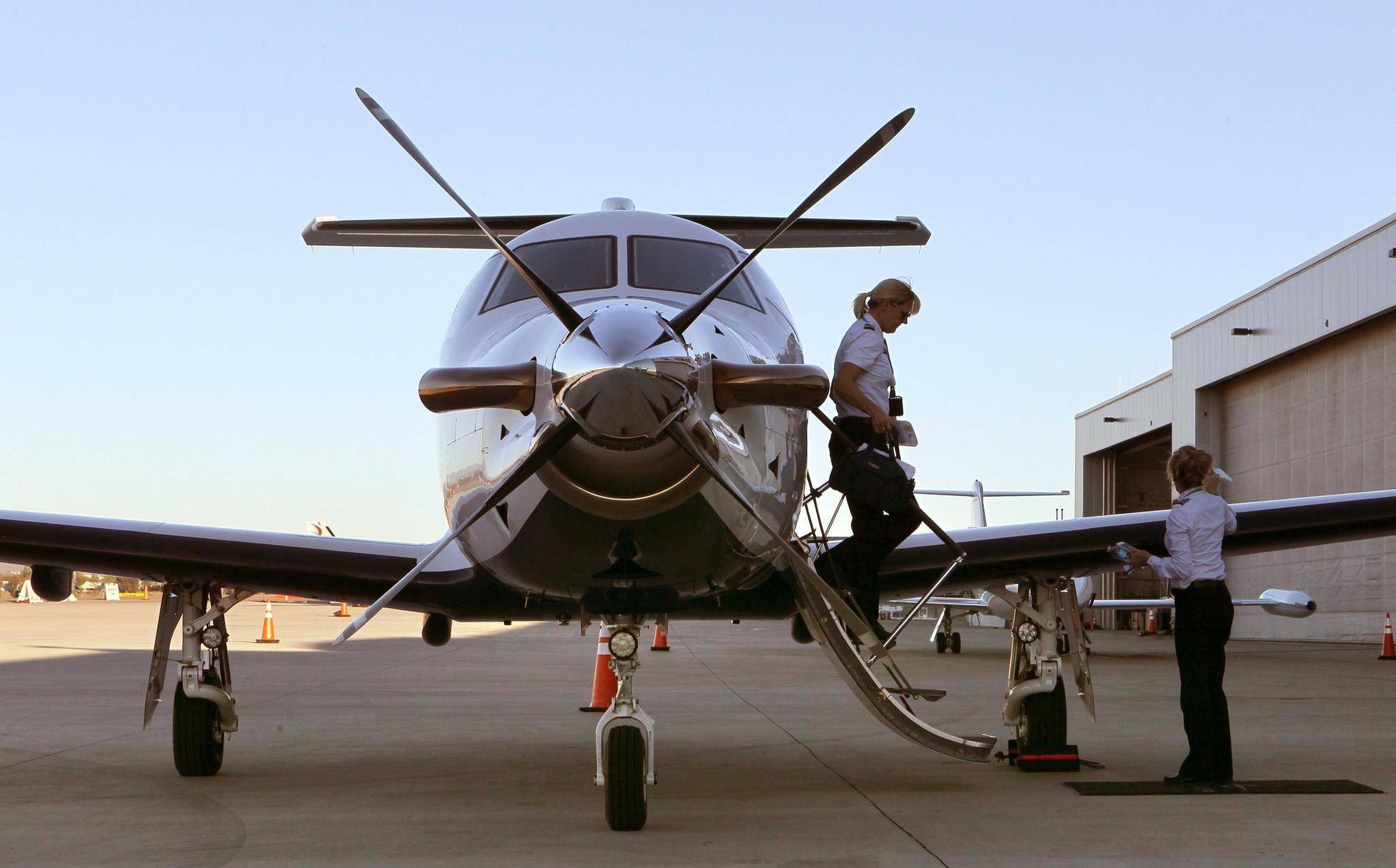 At the Premier Jet terminal at McClellan-Palomar Airport Surf Air Captain Arlene Wilske exits the plane she helped pilot there from Santa Barbara.