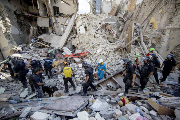Crews find living among the dead as search goes on for survivors of Italy quake that killed 250
