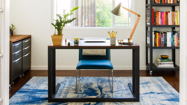 A messy home office gets a sleek, stunning makeover