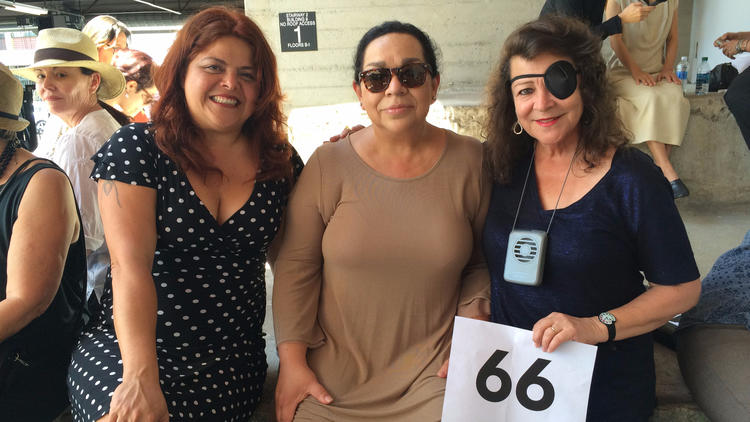 Painter Sandy Rodriguez, left, photographer Isabel Castro and multimedia artist Barbara Carrasco came out to participate in the group portrait.