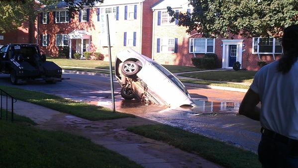 Car falls into sinkhole in Rodgers Forge