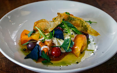 Caprese salad with heirloom tomato skin chips