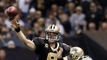 New Orleans Saints Quarterback Drew Brees Looks For A Receiver In The First Half Of An