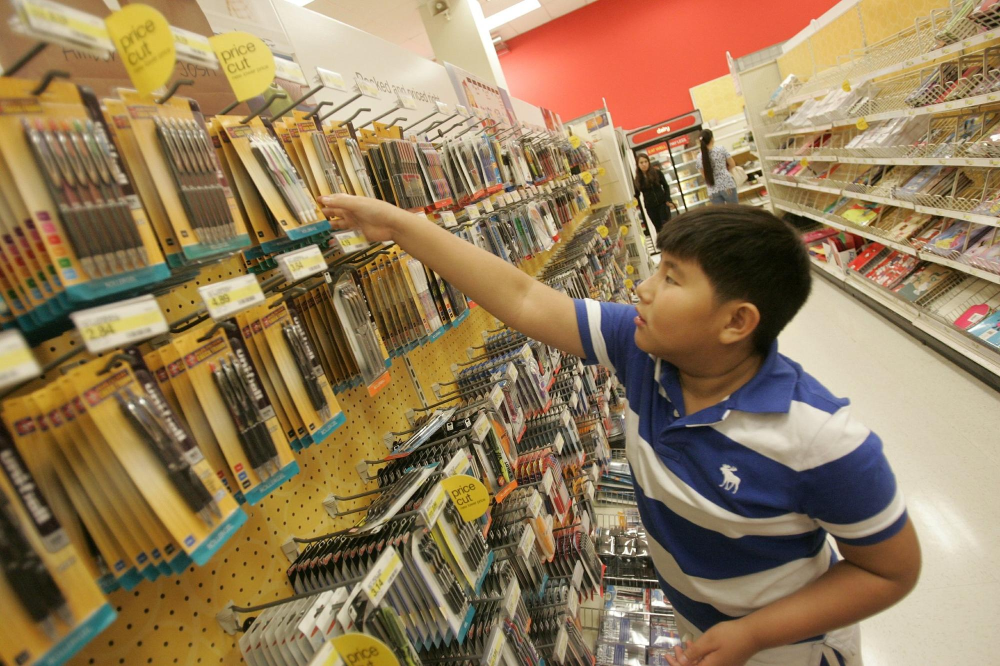 Aaron Ngo,10, of City Heights, a 5th grader at Euclid Elementary School, looks for school supplies at the Target store in Mission Valley the day before the new school year begins