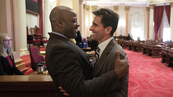 Outgoing Democratic state Sens. Isadore Hall III of Compton, left, and Mark Leno of San Francisco share a moment on the last day of the two-year legislative session. (Rich Pedroncelli / Associated Press)