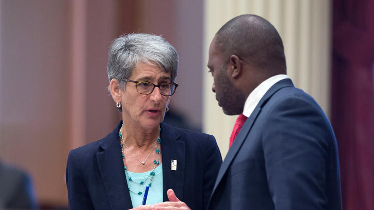 State Sen. Hannah Beth Jackson D Santa Barbara talks with Assemblyman Tony Thurmond D-Richmond at the Capitol in August