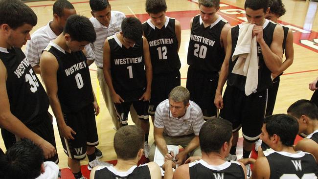 westview high boys basketball coach kyle smith instructs his players wednesday during a timeout of their