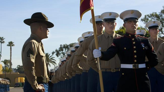 marine recruits remained under the gaze of their drill instructor before marching out to begin their