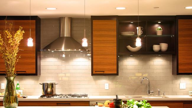 In The New Kitchen, Zebrawood Cabinets Are Framed In Ebony Wood, And All  Counters