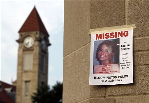 A missing person poster of Lauren Spierer 20 is posted on one of – Missing Person Poster