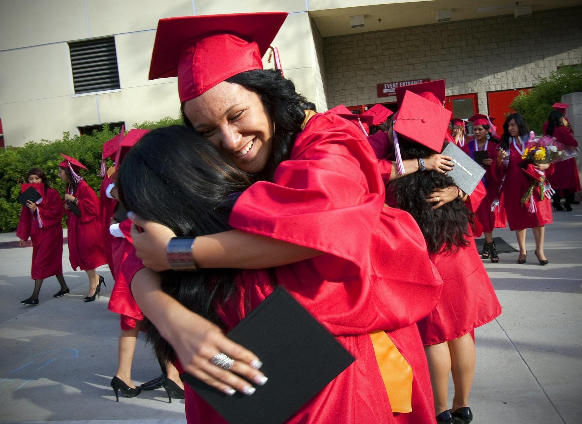 June 10, 2011, San Diego, California, USA ....................    |At Hoover High School's graduation held on campus at SDSU, Viejas Arena, graduates Mayreni Olea  and Daisy Merc