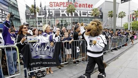 5613414a5 Los Angeles Kings mascot Bailey high-fives the fans outside Staples Center  before a parade