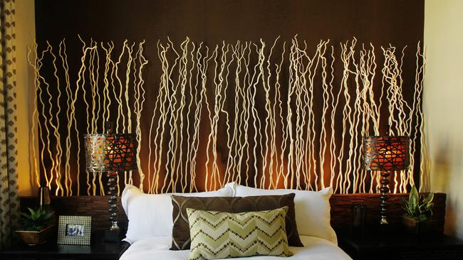 Branches and rope lighting make a dramatic headboard. & Tap into your DIY designer muse - The San Diego Union-Tribune azcodes.com