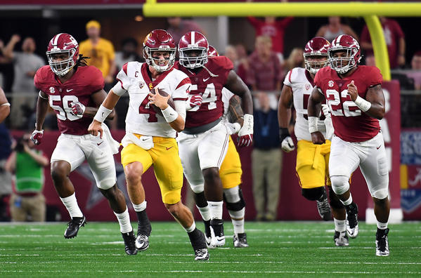 USC quarterback Max Browne picks up some yards while being pursued by the Alabama defense in the first quarter Saturday. (Wally Skalij / Los Angeles Times)
