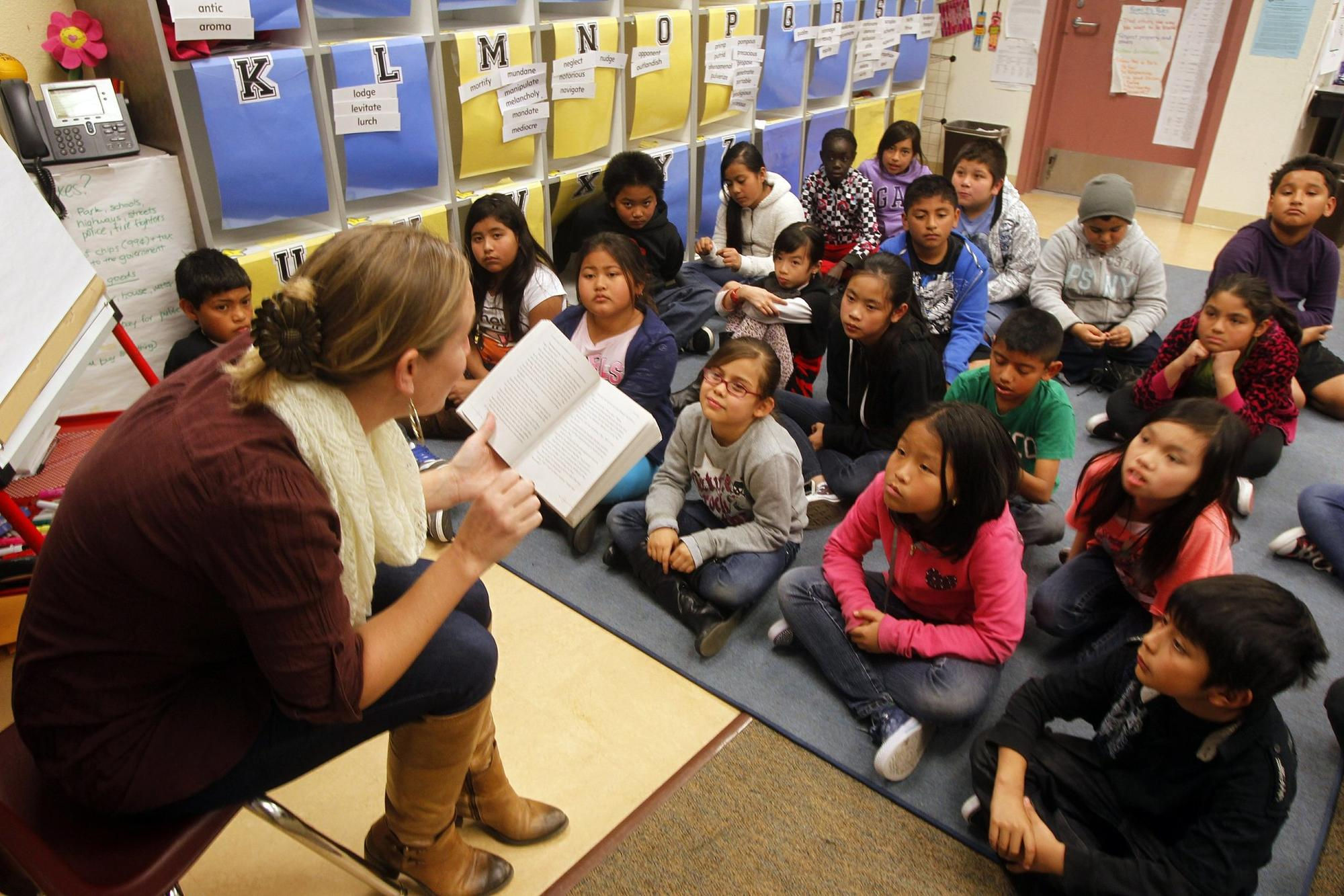 Teacher Tina Rasori reads to her 4th & 5th grade combined class last week at Fay Elementary School in San Diego. New common core standards for California schools have been implem