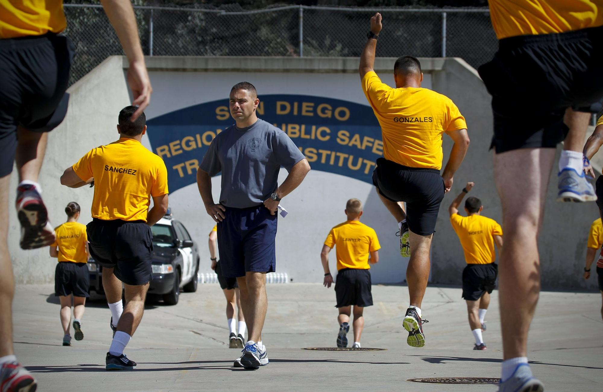 Geoff DeCesari, recruit training officer at the San Diego Regional Public Safety Training Institute in Mira Mesa at Miramar College, watches San Diego police and sheriff's recrui