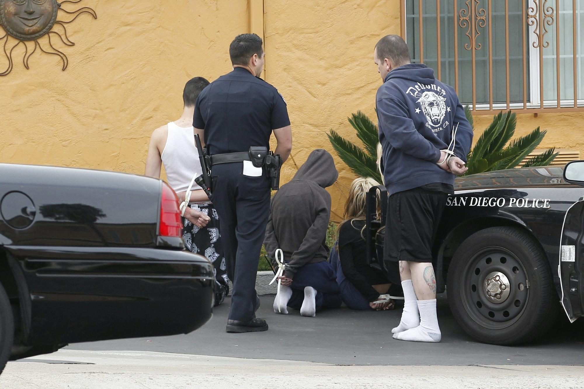 San Diego police and other agencies arrested 14 gang members and associates in San Diego Wednesday morning, while another two were nabbed in Arizona and one in New Jersey.
