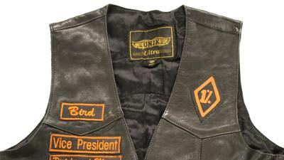 "A leather vest worn by a member of the Pistoleros biker club is among the artifacts displayed in the ""Outlaw Motorcycle Gangs"" exhibit."