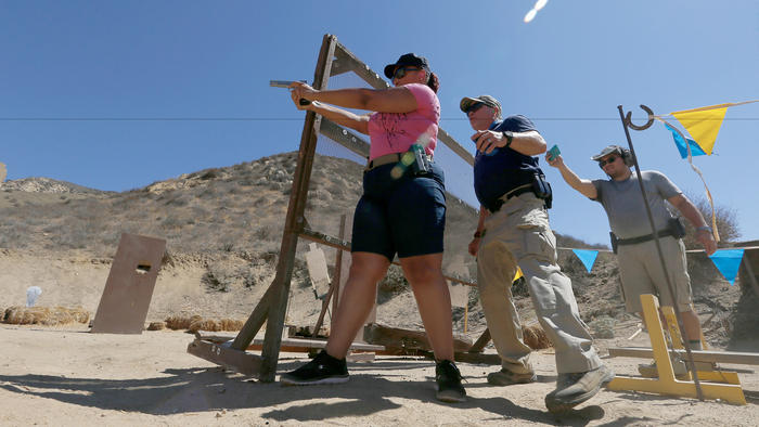 Gun owner Elizabeth Southern, left, trains with a handgun at a gun range near Piru.