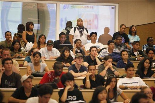 Students stand in the back row of a filled chemistry class at the California State University East Bay in Hayward, Calif., Wednesday, Sept. 23, 2009. Over 50 students were on a w