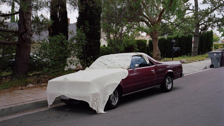 """An image from the series """"Under Cover Cars,"""" by Clint Woodside."""