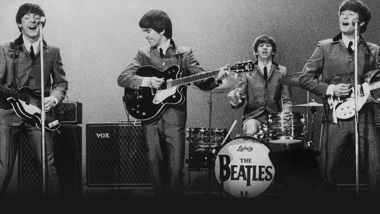 The Beatles perform at a Washington Coliseum concert on Feb. 11, 1964. (Robert Freeman / Apple Corps Ltd)