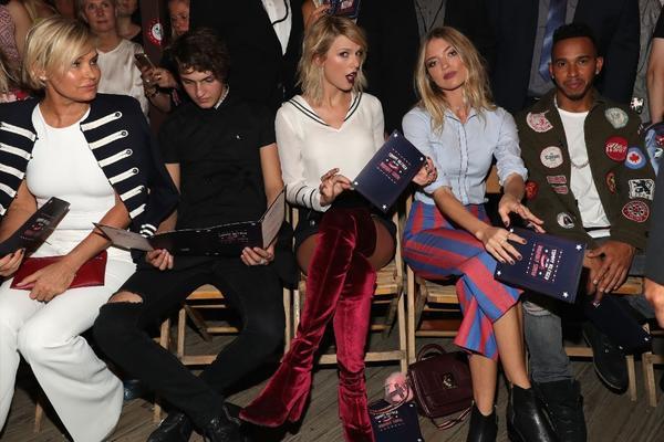 Yolanda Hadid, Anwar Hadid, Taylor Swift, Martha Hunt, and Lewis Hamilton attend the #TOMMYNOW women's fashion show. (Getty Images)