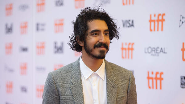 "Dev Patel walks the carpet for his new movie ""Lion"" at the Toronto International Film Festival. (Geoff Robins / AFP/Getty Images)"