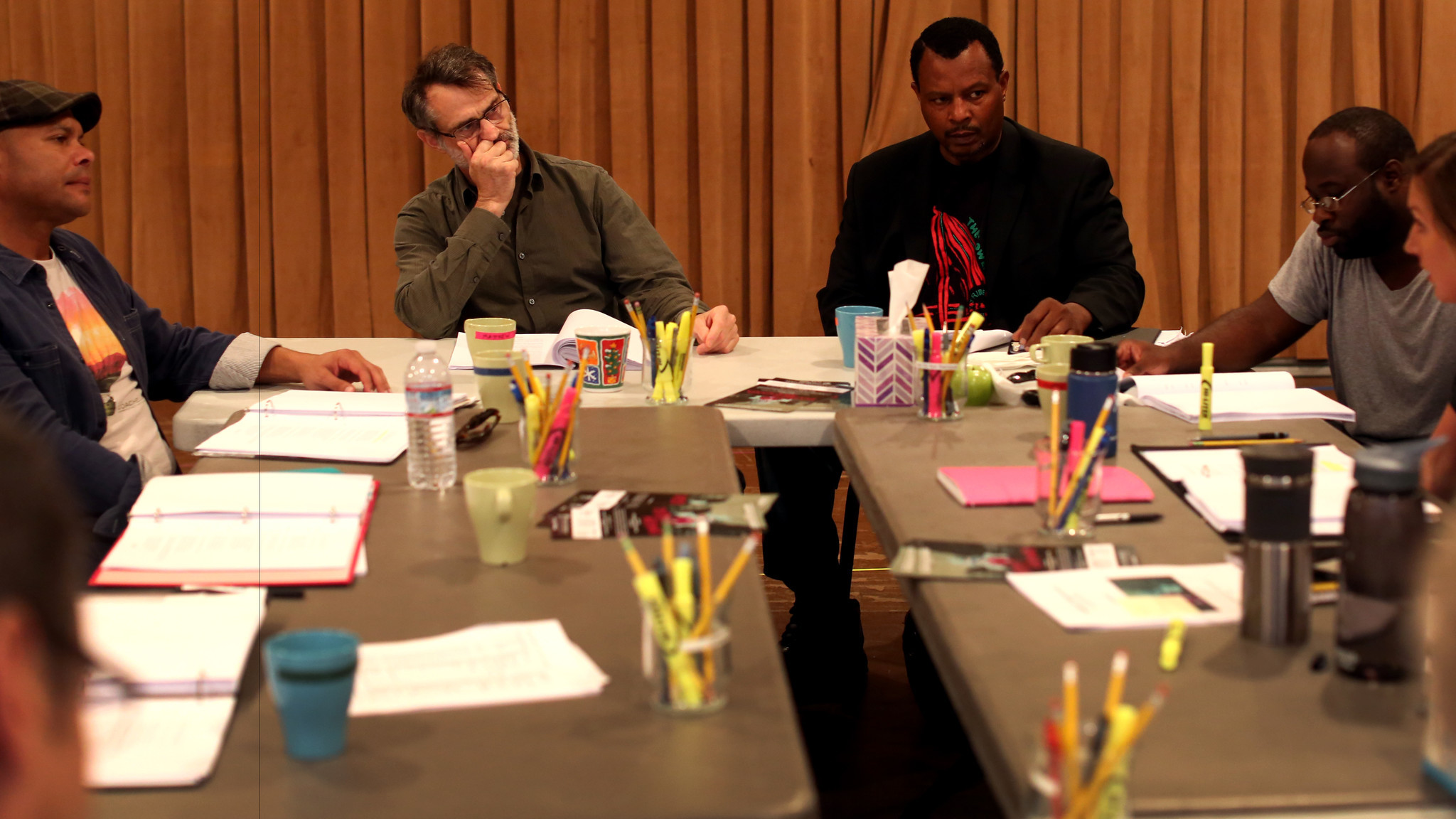 "The ""District Merchants"" cast reads through the script early in rehearsals at South Coast Repertory. From left, Chris Butler (Bassanio), Matthew Boston (Shylock), Montae Russell (Antoine), Akeem Davis (Lancelot) and Helen Sage Howard Simpson (Portia)."