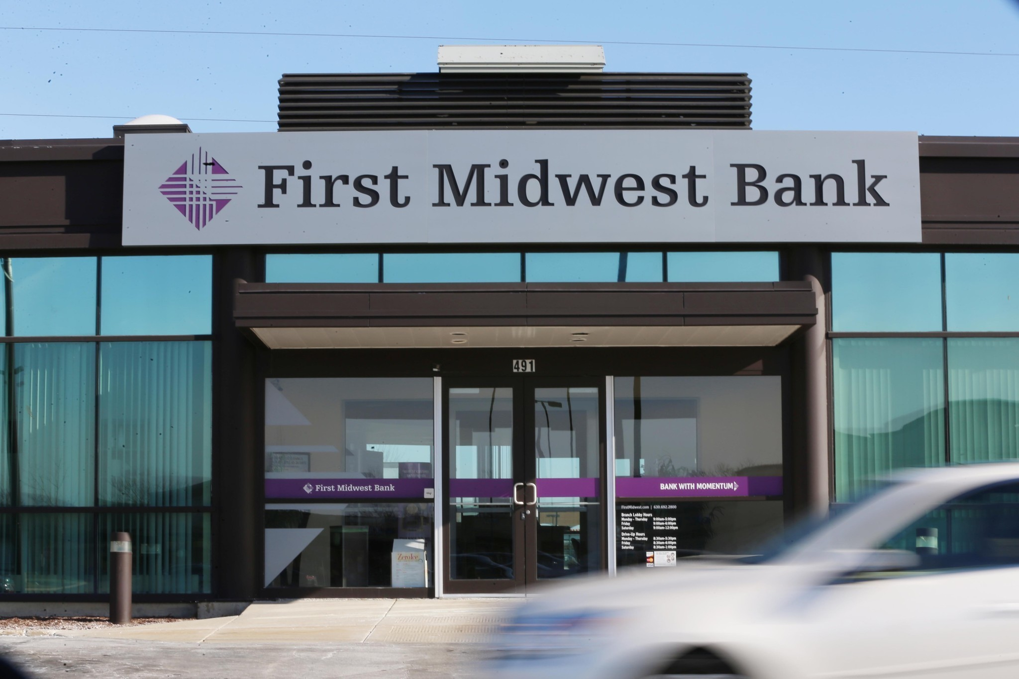 first midwest to close 16 branches after standard bank deal