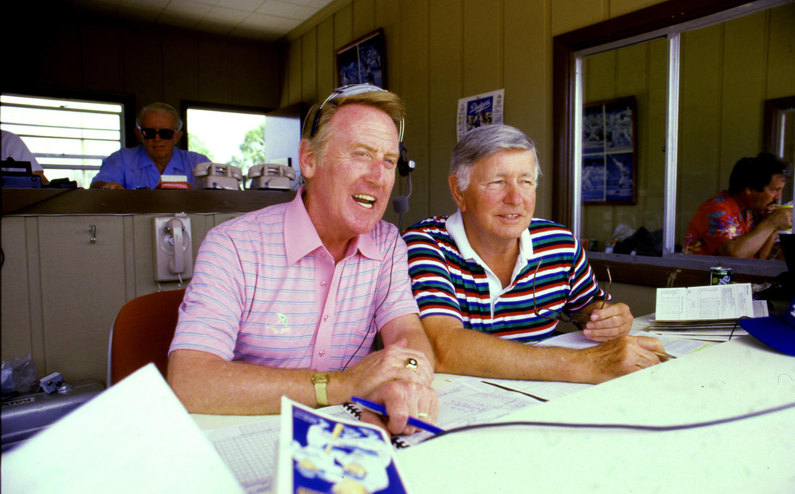 Vin Scully with Jerry Doggett in the announcer's booth at Dodgertown during spring training in Vero Beach, Florida on April 8, 1985.