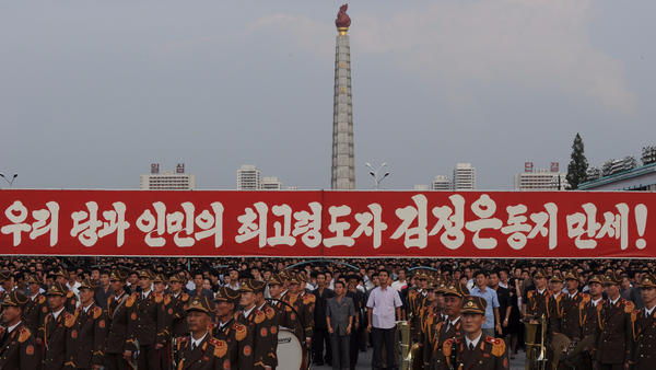 Participants stand behind a military band in Pyongyang, North Korea, on Sept. 13 during a celebration rally after the country's successful test of a nuclear warhead. (Kim Won-Jin / AFP/Getty Images)