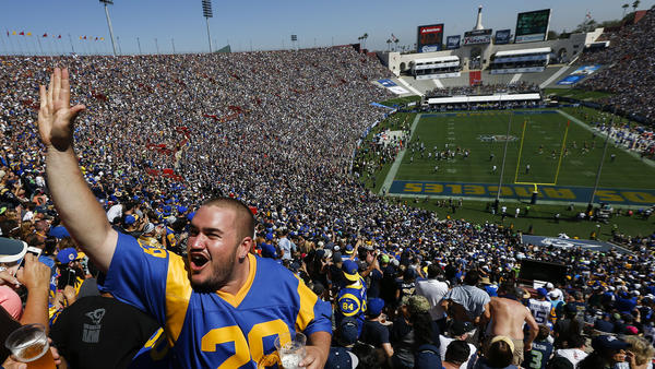 Fans celebrate during the Rams' first home opener in L.A. since 1994 on Sunday at the Coliseum. Click the image for more photos. (Patrick T. Fallon / For The Times)