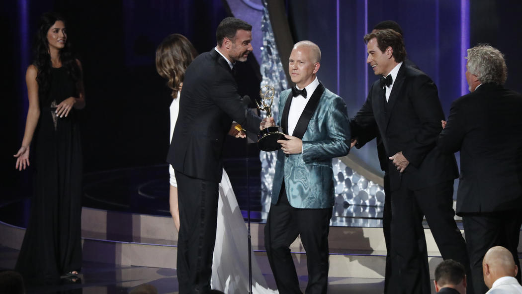 "Ryan Murphy, left, and John Travolta accept the award for limited series for ""The People v. O.J. Simpson: American Crime Story."" (Robert Gauthier / Los Angeles Times)"