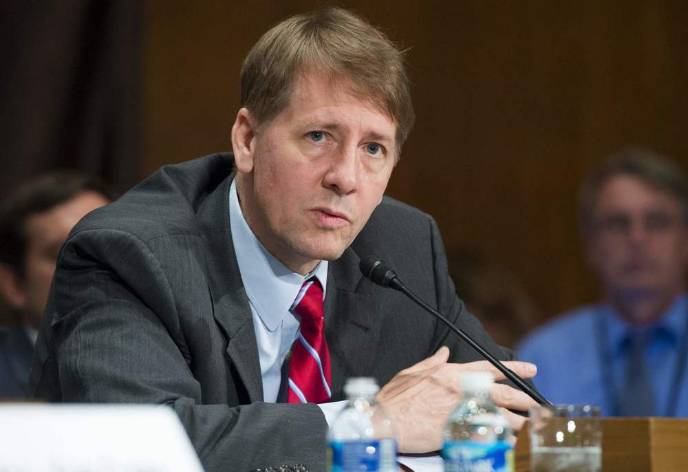 Richard Cordray, director of the Consumer Financial Protection Bureau, testifies. (AFP/Getty Images)