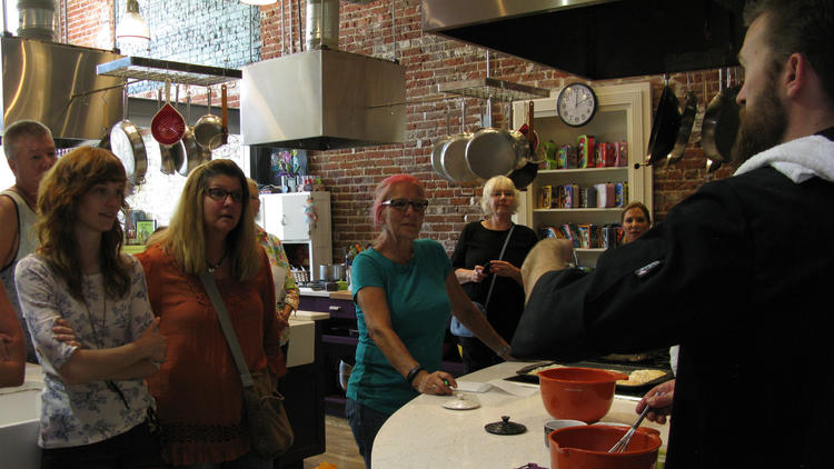 "Participants watch as Travis French prepares lunch during a My 420 Tours ""Cooking with Cannabis"" class in Denver."