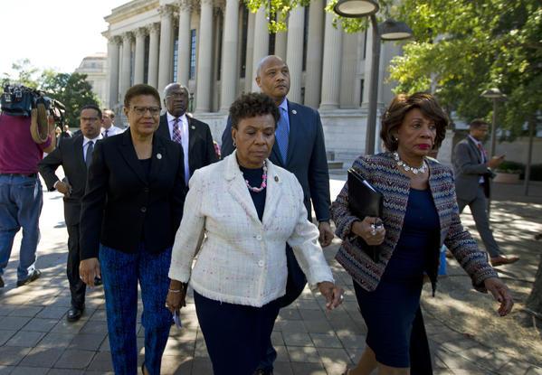 From left, Reps. Karen Bass, Barbara Lee and Maxine Waters of California walk toward the Justice Department. (Jose Luis Magana/Associated Press)
