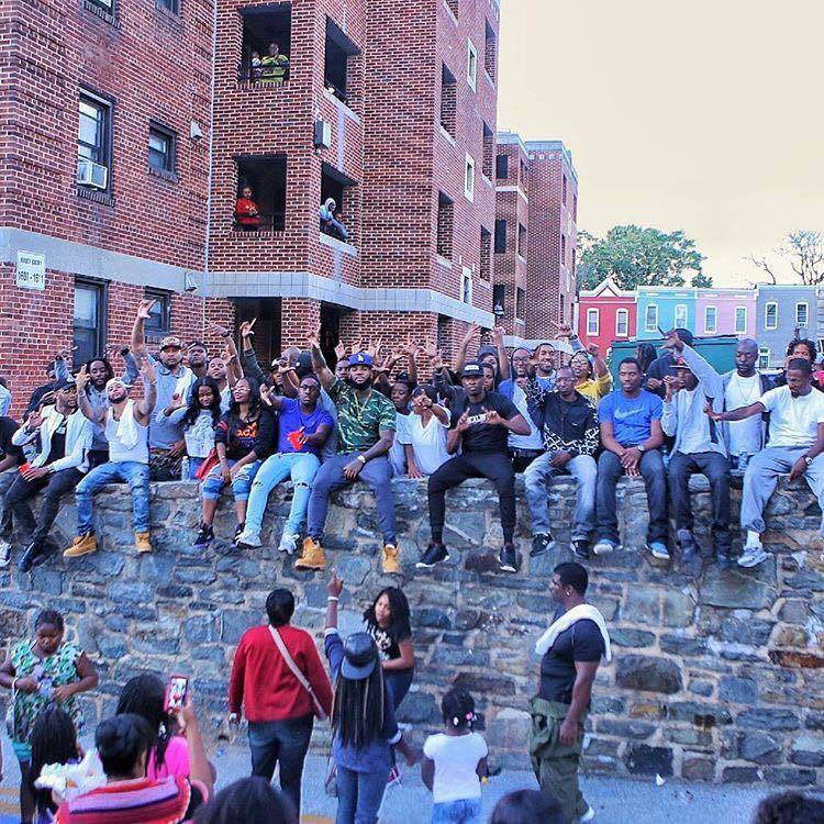 rapper the game makes generous appearance at west baltimore block party