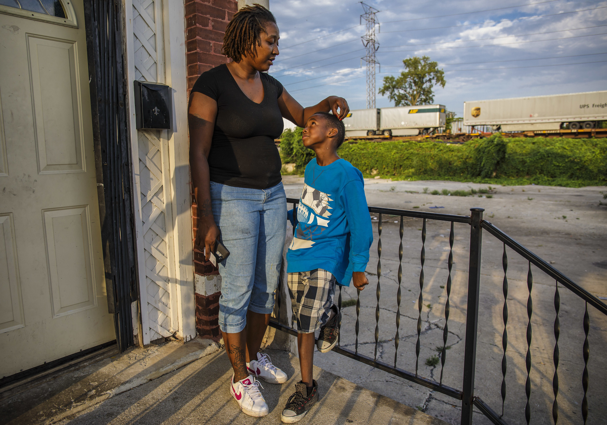 Back to previous page home garfield holiday celebrations - Nine Year Old Eddion Leaned Against His Mother Angela Rankins On The Stoop Of Their East Garfield Park Row House Asking For A Quarter To Follow His