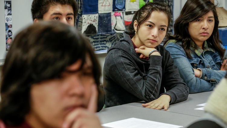 Students at Animo Ralph Bunche High School listen as Gabriella Karin describes her childhood in Nazi-era Slovakia.